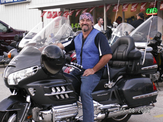 Rider on a Goldwing with Evaporative Cooling vest and Evaporative cooling Scull cap